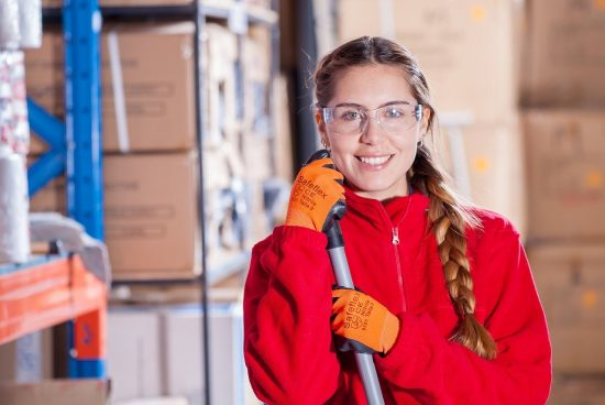 smiling woman leaning on a broom - education cleaning services in Chicago